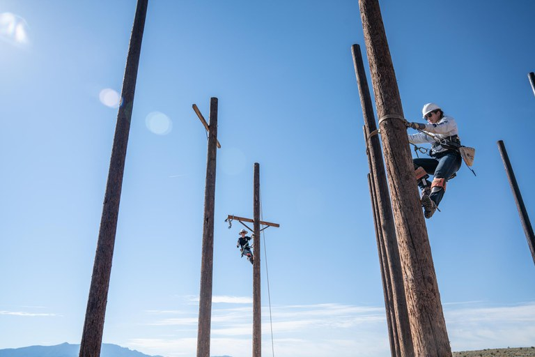 Faith climbing a pole at the Rio Rancho campus.
